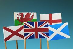 A United kingdom flag and their members as Scotland, England, Nothern Ireland, Wales. Blue and dark background stock photography