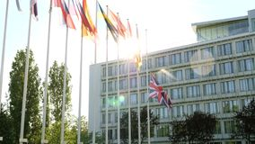 United Kingdom flag Union Jack flag waving half-mast after Manchester attack. United Kingdom flags fly half-mast Council of Europe building memory of victims stock video footage