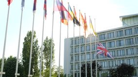 United Kingdom flag Union Jack flag waving half-mast after Manchester attack. United Kingdom flags fly half-mast Council of Europe building memory of victims stock footage