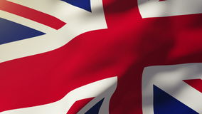 United Kingdom flag waving in the wind. Looping. Sun rises style stock footage