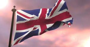 Flag of United Kingdom waving at wind at sunset, loop. United Kingdom flag waving at wind at sunset, loop stock video
