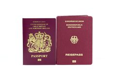 United Kingdom and German biometric passports on a white background royalty free stock photos