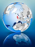 United Kingdom on globe. United Kingdom on political globe standing on reflective surface. 3D illustration Stock Photo