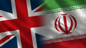 United Kingdom and Iran. Two Flag Together - Fabric Texture stock images