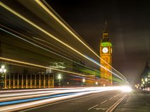 Big Ben at night. UNITED KINGDOM, LONDON - APRIL 26, 2015: Big Ben at night with the lights of passing traffic Royalty Free Stock Images