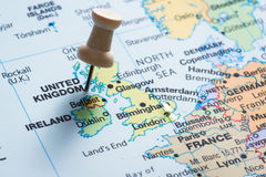 United Kingdom on a map. Close up of a world map focused on the UK marked with a push pin Royalty Free Stock Photography