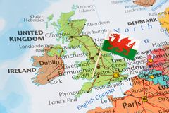 United kingdom map, flag of Wales, brexit concept. Paper flag pin of Wales, which is a part of the United Kingdom of Great Britain. Brexit concept Stock Images
