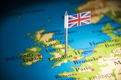 United Kingdom marked with a flag on the map.  stock photo