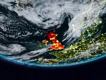 United Kingdom during night. United Kingdom on Earth at night with visible country borders. 3D illustration. Elements of this image furnished by NASA Royalty Free Stock Photo
