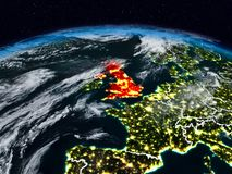 United Kingdom at night. United Kingdom from space at night on Earth with visible country borders. 3D illustration. Elements of this image furnished by NASA Royalty Free Stock Image