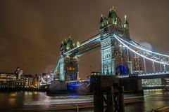 Illuminated glow Tower Bridge in London at night royalty free stock images