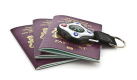 United Kingdom passports. Three United Kingdom passports with compass on whithe background Royalty Free Stock Photography