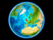 United Kingdom on planet Earth. United Kingdom in red on planet Earth as seen from space on full sphere. 3D illustration. Elements of this image furnished by Royalty Free Stock Image