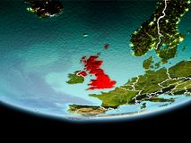 United Kingdom in red in the evening. Country of United Kingdom in red on planet Earth in the evening with visible border lines and city lights. 3D illustration Stock Photos