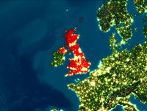 United Kingdom in red at night. Satellite night view of United Kingdom highlighted in red on planet Earth. 3D illustration. Elements of this image furnished by Royalty Free Stock Photos