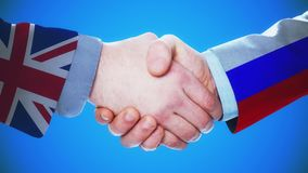 United Kingdom - Russia / Handshake concept animation about countries and politics / With matte channel. Handshaking of the men wearing flag pattern suit 4K stock video