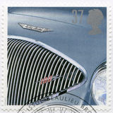 UNITED KINGDOM - 1996: shows Austin-Healy 100, series Classic British Sports Cars. UNITED KINGDOM - CIRCA 1996: A stamp printed in United Kingdom shows Austin royalty free stock images