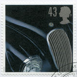 UNITED KINGDOM - 1996: shows Jaguar XK 120, 1948, series Classic British Sports Cars. UNITED KINGDOM - CIRCA 1996: A stamp printed in United Kingdom shows Jaguar Royalty Free Stock Photo