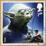 UNITED KINGDOM - 2015: shows portrait of Yoda, series Star Wars, The Force Awakens Royalty Free Stock Photos