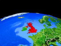 United Kingdom from space on Earth. United Kingdom on model of planet Earth with country borders and very detailed planet surface. 3D illustration. Elements of stock illustration