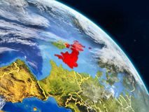 United Kingdom from space. On realistic model of planet Earth with country borders and detailed planet surface and clouds. 3D illustration. Elements of this stock illustration