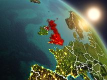 United Kingdom from space during sunrise. Sunset above United Kingdom from space on planet Earth with visible country borders. 3D illustration. Elements of this Royalty Free Stock Images