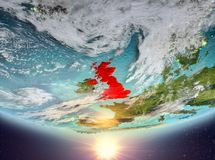 United Kingdom with sun. United Kingdom during sunrise highlighted in red on planet Earth with clouds. 3D illustration. Elements of this image furnished by NASA Royalty Free Stock Image