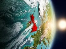 United Kingdom during sunrise. Highlighted in red on planet Earth with visible country borders. 3D illustration. Elements of this image furnished by NASA Royalty Free Stock Images