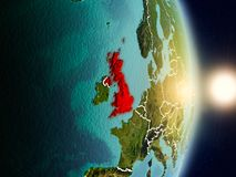 United Kingdom during sunrise. Highlighted in red on planet Earth with visible country borders. 3D illustration. Elements of this image furnished by NASA Stock Image