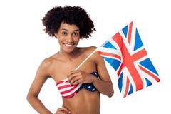 United Kingdom supporter in American flag bikini Stock Photography