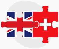United Kingdom and Switzerland Flags in puzzle isolated on white background Royalty Free Stock Photo