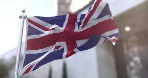 United Kingdom or UK Flag flagstaff Slow motion seamless loop