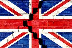 Brexit United Kingdom UK flag painted on cracked divided brick wall. Concept image for Great Britain, British, England, Brexit royalty free stock image