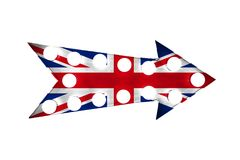 United Kingdom UK flag painted over a vintage bright and colorful illuminated metallic display arrow sign with light bulbs Royalty Free Stock Photography