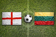 United Kingdom vs. Lithuania flags on soccer field Royalty Free Stock Images