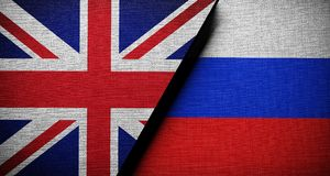 United Kingdom Vs Russia Flag Concept Cloth Texture Royalty Free Stock Photography