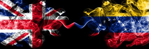 United Kingdom vs Venezuela, Venezuelan smoky mystic flags placed side by side. Thick colored silky smoke flags of Great Britain. And Venezuela, Venezuelan stock illustration