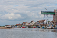 United Kingdom - Wells Next The Sea. Fishing and pleasure boats during low tide against a cloudy sky in the harbour of Wells Next The Sea, Norfolk Royalty Free Stock Image