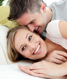 United lovers having fun together on a sofa Royalty Free Stock Image