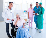 United medical team taking care of a senior woman Royalty Free Stock Photography
