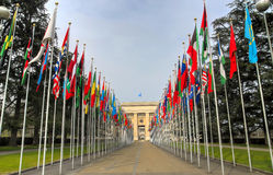 United Nation building, Geneva, Switzerland. United Nation building entrance with the flags of all nations world wide on both sides in Geneva, Switzerland. HDR Stock Photos