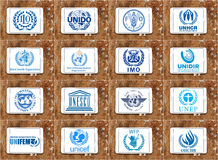 United nations agencies logos and icons. Collection of logos and vector of most popular united nations agencies on white tablet on rusty wooden background Royalty Free Stock Photos