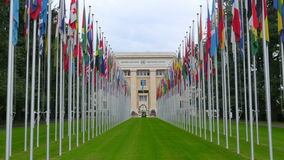 United Nations building with flags, Geneva, Switzerland, 4K stock video