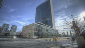 United Nations Building. NEW YORK CITY - Feb 12: HDR Timelapse of the United Nations Builing on 1st Ave with traffic passing by at daytime on February 12, 2012 stock video footage