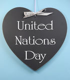 United Nations Day text message greeting written on heart shape blackboard Stock Image