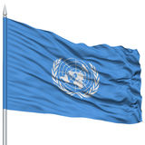 United Nations Flag on Flagpole. Flying in the Wind, Isolated on White Background stock photography