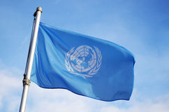 United Nations Flag Flying in Wind Stock Photo