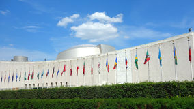 United Nations General Assembly. The United Nations General Assembly building, in New York City. The flags of its member countries are outside, in alphabetical Royalty Free Stock Photography
