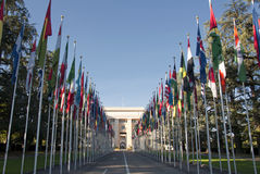 The United Nations  in Geneva - Switzerland. Avenue with many national flags at the entrance to the United Nations building in Geneva, Switzerland Royalty Free Stock Photography
