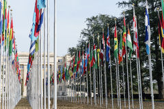 United Nations in Geneva. View of the entrance to United Nations (Palace of Nations) and the gallery of the National Flags in Geneva, Switzerland Stock Photos